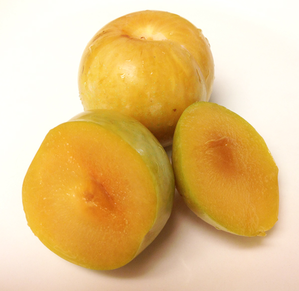 Fresh sliced yellow plums